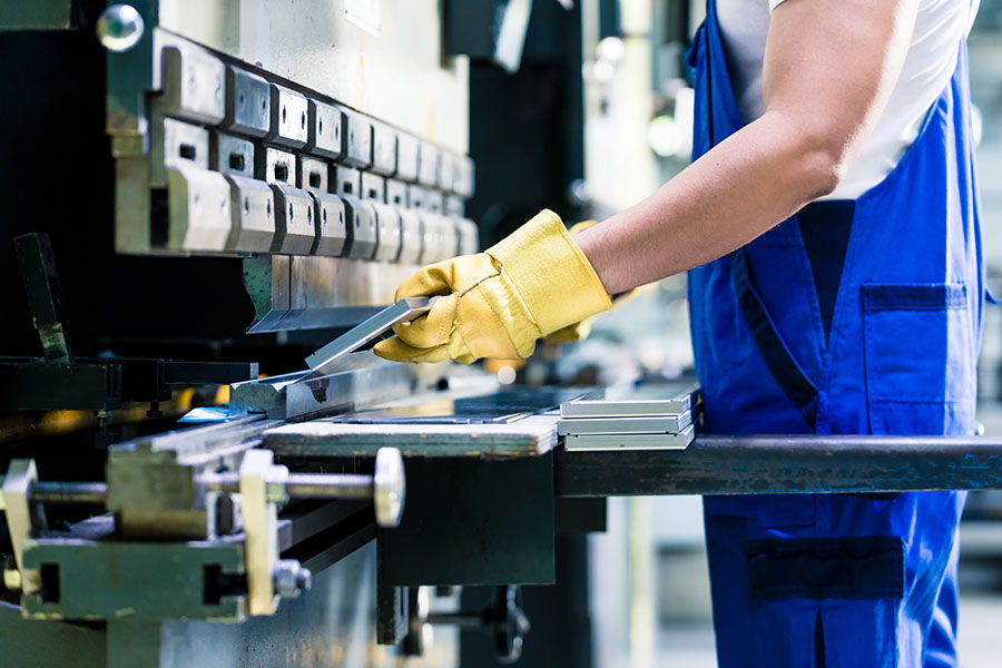 Specialized Business Insurance - Factory Worker Manufacturing Metal At Facility